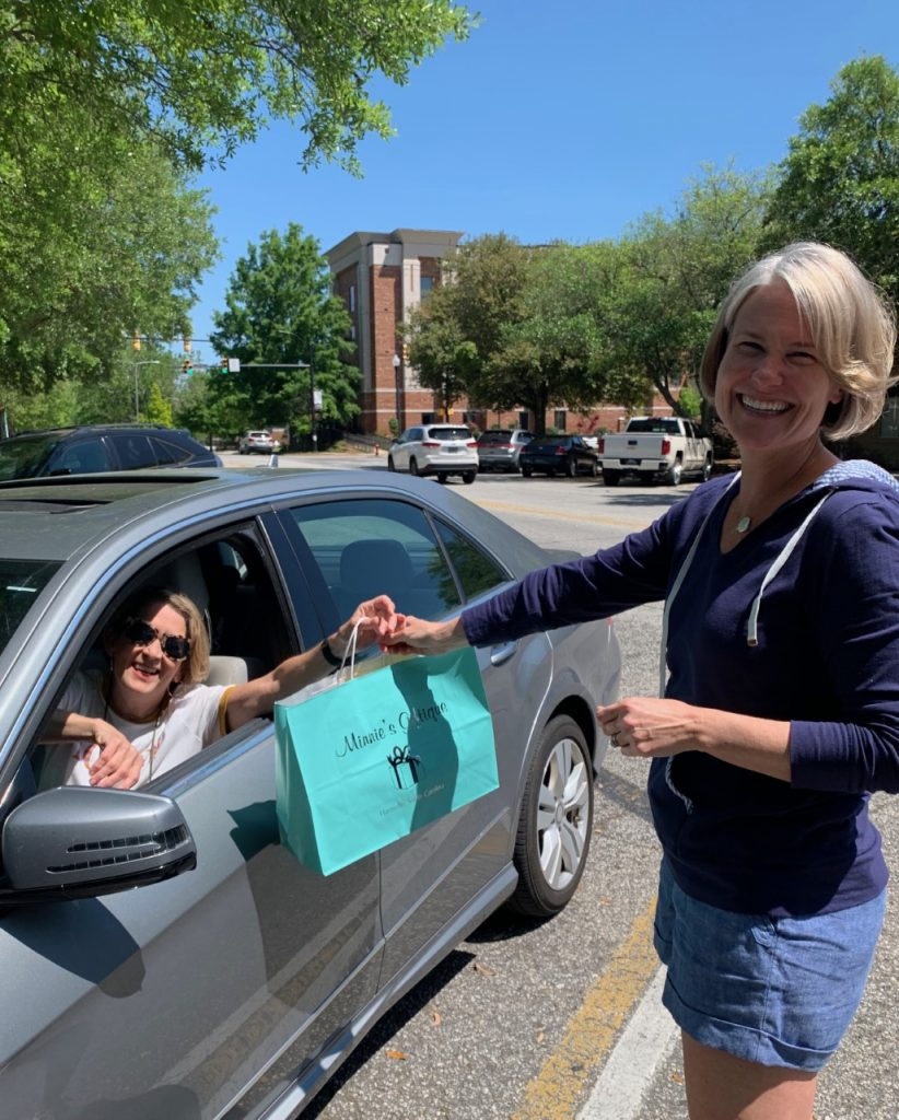 Megan Porter-Grant delivers essential Springtime gifts curbside to loyal customer Terrie Reames.