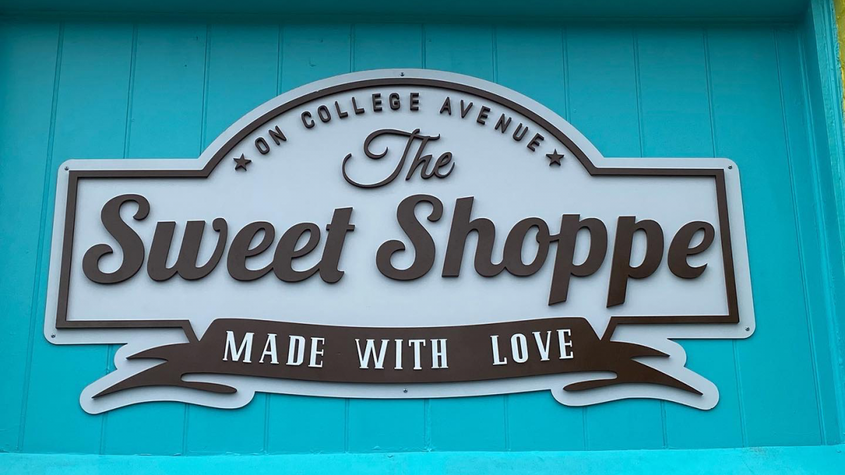 The main sign over the entrance of The Sweet Shoppe