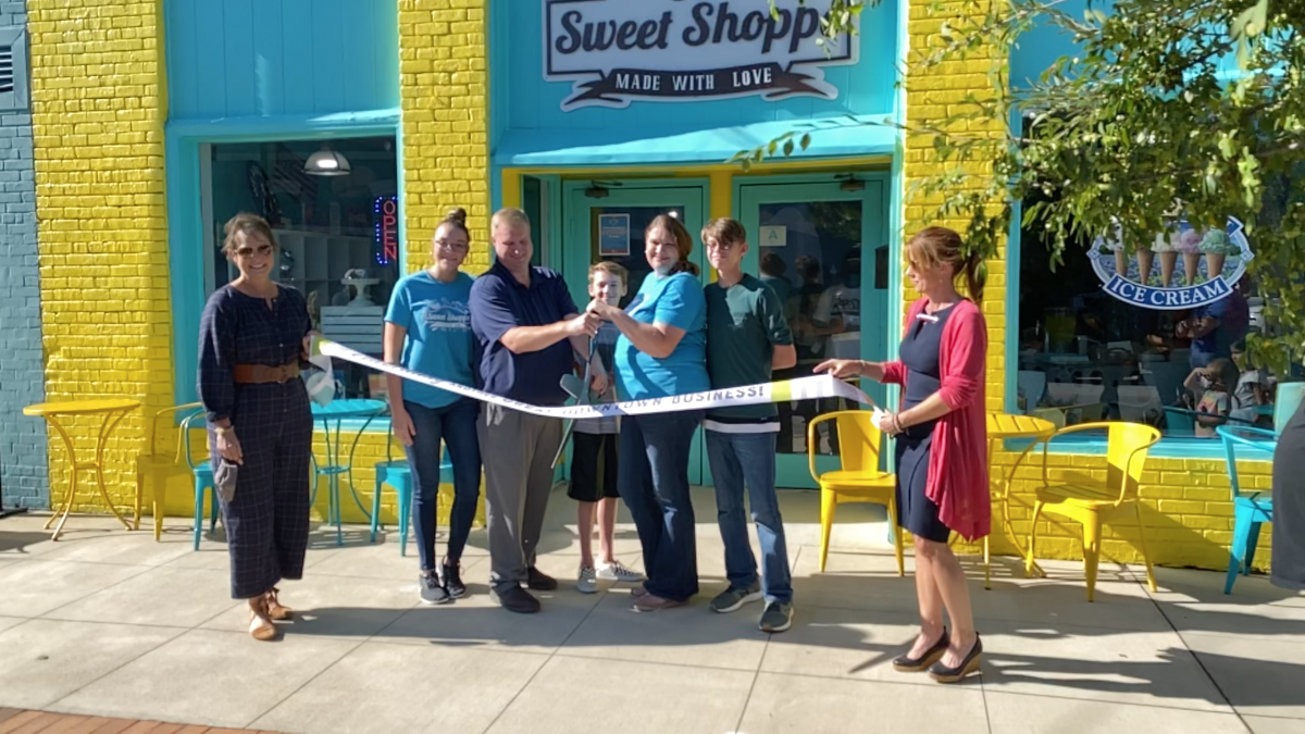 The ribbon being cut at the grand opening of The Sweet Shoppe